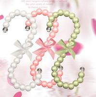 Wholesale 0701 plastic pearl bag hanger CM Fashion women clips White Pink S shaped bag hook clothes rack color