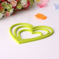 Wholesale Milk green pure color fashion soulmate is irregular shape antiskid insulated pad Table and heat resistant pot pad thickening large kitchen