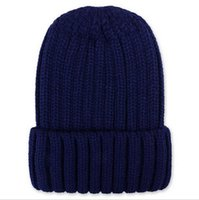 Wholesale new autumn winter thickening Stoned knitting wool cap flanging pure color pointed is land Men s and women s hat
