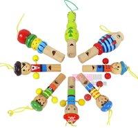 Wholesale baby toy cartton partern kids toy wood cartoon whistle key pendant whistling dozen random shape