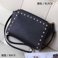 Wholesale star models with cross pattern PU leather handbags and small rivet smiley bat bag shoulder bag Messenger bag