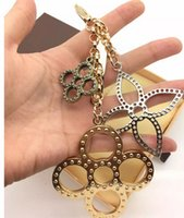 antique brown glass bottles - flowers perforated Mahina leather TAPAGE BAG CHARM M65090 Key Holder Box comes with