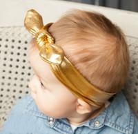 Compra Sombrero de estiramiento-Shiny Metallic Bunny Orejas headband / estiramiento Bebé cabeza envuelve con chic bowtie cabrito cabello accesorios, de buena calidad niño mini sombrero headwear