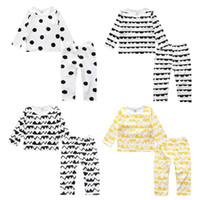 al por mayor pijamas de los nuevos niños-Año Nuevo del bebé determinado de la muchacha ropa de China Trajes de Navidad Kid pijamas de manga larga tapa de la camiseta + Pant 2PC juego de los niños Pijamas Boutique