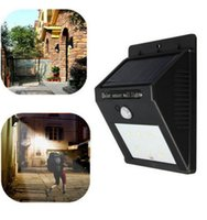 Wholesale Solar Powered Waterproof IP65 LED Outdoor Lighting Lamp PIR motion sensor and ray sensor White LED Street Light Wall Garden Lamp