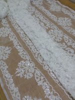 Wholesale Embroidered beaded lace fabric white ivory black colors for wedding dress high end sequins pearls jacquard lace fabric material
