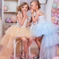 2016 Top Girl desfile de vestidos increíbles alto-bajo del vestido del cordón de la muchacha con gradas sin tirantes de tul falda de la flor para las bodas de niños vestidos formales de encargo