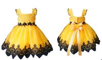 achat en gros de jupe jaune mignon-Nouveau 2016 Robe jaune Cupcakes avec dentelle noire et Jewel taille Little Girls Pageant Robes Ruffles Infant boule Robes Mignon Mini jupes bébé