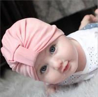 al por mayor algodón chicas calientes-CALIENTE 9 niños de los colores Benies vende al por mayor los accesorios recién nacidos de la fotografía bebés muchachas sombreros de los muchachos anudaron los sombreros del invierno del otoño del algodón de los sombreros de Bohemia del invierno