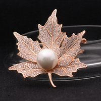 Wholesale Maple leaf with pearl brooch zircon inlaid small gift two colors Christmas jewelry to USA