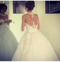 beaded bridal lace trim - 2016 Beaded Ball Gowns Wedding Dresses High Lace Trimming Neck Sheer Illusion Bodices Floor Length Middle East Style Bridal Gowns