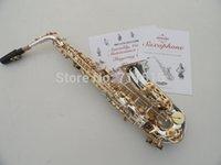 Clé eb Avis-Gros-Marque SUZUKI Saxophone alto plaqué instruments de musique saxophone alto chute Tune E (F) surface d'argent / or clés Sax SAX-400S