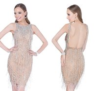 beadwork pictures - Halter Prom Dresses With low cut open back and extravagant Fringe Beadwork Through Nude lined body A Sheer Mesh Lace Underlay HY1601