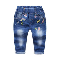 Wholesale 2016 kids clothing kids clothes Autumn Fruit embroidery water laundry soft denim trousers of the girls