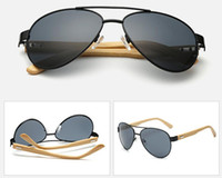 Wholesale 2016 summer fashion new designs high quality wooden sunglasses alloy frames and bamboo legs OEM is availabel