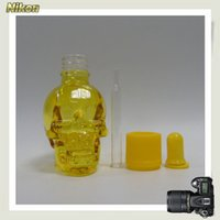 baby bottle liquid - Hot ml yellow empty skull head glass baby bottles glass dropper e liquid bottle with colorful cap