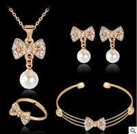 Wholesale Bowknot Is Imitation Pearl Crystal Jewelry Bracelet Necklace and Earrings Ring Jewelry Set