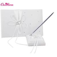 Nueva marca personalizada libro de invitados de boda pluma conjunto con arcos de satén boda boda decoración libro de invitados de la boda con la pluma