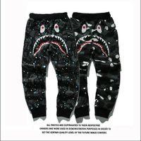 achat en gros de pantalons zippés-Hip-hop logo populaire le produit se vendent comme des gâteaux chauds Hommes Shark Head Japon Aape Luminous pantalons de camouflage Flight Zip automne pantalons de sport