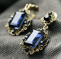 Nuevos pendientes de moda de moda del banquete de boda pendientes de la resina de vidrio Zinc Aloy mujeres favoritas de moda tallados Moonstone de zafiro azul pendientes