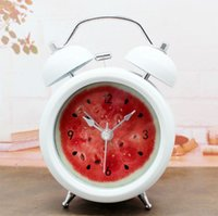 Cheap Cool creative fashion watermelon fruit metal ringing alarm clock with night light bedside lazy mute watch home decor shipping