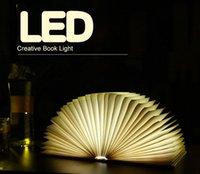 Wholesale Creative flip four color books v light night light USB charging LED folding book lights decorative bedside lamp