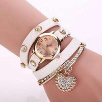 Le commerce de la peau Avis-drill pleine peau table de litchi pendentif diamant bracelet de montre de mode féminine en forme de coeur montre en gros commerce extérieur gros