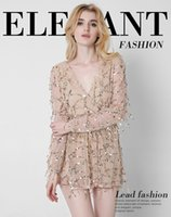 Wholesale Hot Sexy European and American women new long sleeved deep V dress sexy gauze tassel sequined skirt