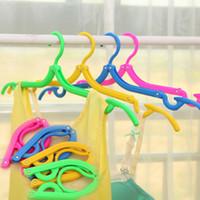 Wholesale Portable Travel Non slip Hanger on Business Tourism Magic Hangers Color Plastic Folding Clothes Rack Drop Shipping