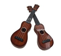 Wholesale The booth sale Archaize guitar Imitation wood plastic guitar Especially in the kerry instruments Children s educational toys guitar