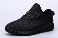 Venta al por mayor de la fábrica en la primavera de zapatos de coco de Kanye Zapatos negros de las mujeres grises de las mujeres Zapatillas de deporte Zapatos ocasionales Los zapatos calientes superventas