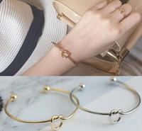 al por mayor 18k brazaletes de oro diseña-Europa apertura Tie a nudo Brazaletes Simple Diseño 18K oro plateado Brazalete Brazalete Cufflink Accesorios Enviar el Regalo de San Valentín