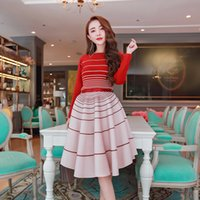 Wholesale women pieces sets fashion stripe knitted sweater shirts knitting striped high waist umbrella skirt crop top and skirts sets