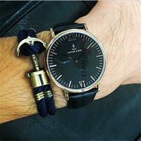 Precio de Gifts-Los relojes de cuero más populares del cuero del regalo de la promoción del diseño de los hombres de la marca de fábrica de KAPTENSON venden al por mayor para el reloj del vestido de la manera de las mujeres