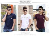 Wholesale 2016 new men s fashion round neck short sleeved T shirt good quality affordable M XXXL black white and purple three colors