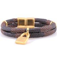 Precio de Broches para los encantos-Venta al por mayor de pulsera de cuero doble y 18 quilates de oro plateado pulsera de acero inoxidable pulsera pulsera de encanto con cierre de imán para las mujeres
