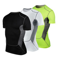 Wholesale 2016 New Men s Short Sleeve Shirts Running MMA Workout Fitness Tight Compression Baselayer Quick Dry Yoga Short Shirts