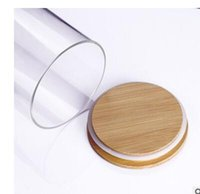 Wholesale Bamboo transparent heat resistant glass sealed cans glass herbal tea bamboo cover the lid