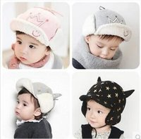 Wholesale Autumn and winter New children s hat plush thicker warm ear protection baby smiling crown Trapper Hats