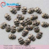 Precio de Órdenes de uñas acrílicas-La orden mínima $ 10 libre shipping12 * 2-sku aleación de bronce 100pcs MetalStuds Nail Art cráneo de 16 mm, el teléfono celular del Rhinestone de acrílico Sticker