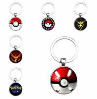 Cheap poke Time gemstone alloy circular glass pendant keychain Cartoon bronze keychain accessories hot sale