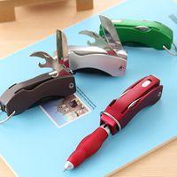 Wholesale Creative stationery Multi function folding light pen Swiss army knife ball point pen LED lamp pen custom LOGO