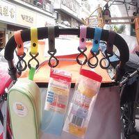 Wholesale New Plastic Baby Stroller Accessories Pram Hooks Pushchair Car Hanger Hanging Strap Random Color High Quality