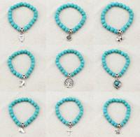 achat en gros de bijoux éléphant turquoise-Charms Vintage Perles Turquoise Owl Elephant Oiseau Collier Bracelet Mode main Croix Bracelets Femmes Pulseras Beaux Bijoux de F007