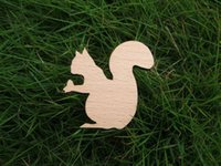 african nuts - squirrel take a nut in hand wooden brooches
