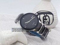 Wholesale The new men s silver female models of high quality stainless steel quartz watch waterproof couple watches fashion gold round