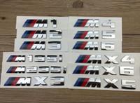 Wholesale 10pcs original ABS Plastic car emblem for BMW M1 M2 M3 M4 M5 M6 x3 x4 x5 x6 m135i m235i