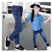 Wholesale Girls jeans pants autumn new large Tong hole jeans pants children clothing trousers