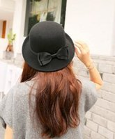 Wholesale Qiu dong the day han2 ban3 bowler hats ms flanging bowknot cloth hat the new trend of England joker felt hat
