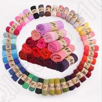 al por mayor pashmina scarf-Bufanda del color sólido de las mujeres Bufanda del color del caramelo de invierno 78 * 180cm Bufandas y bufandas Bufanda del algodón de lino Playa caliente Pashmina 42 colores OOA778